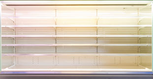 Shop showcase with empty shelves. Background of a showcase or fitting in supermarket or shop with long rows of empty shelves Stock Photography