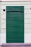 Shop shutter. A closed shop with a metal gate Stock Photo