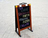 Shop Sign display with Tea Coffee Pasta Offers Stock Photography