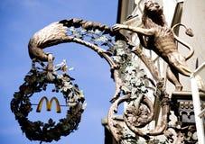 Shop sign Mc Donalds in the Getreidegasse in Salzburg. Iron shop sign Mc Donalds with bird in the main shopping street Getreidegasse in Salzburg/Austria Stock Image