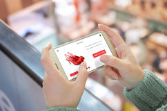 Shop with smart phone. Mobile in horizontal position in woman hand Stock Image