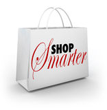 Shop Smarter Find Deals Discounts Sale Prices Bag. Shop Smarter words on a store shopping bag to carry your bargains and special discount merchandise and Royalty Free Stock Photography