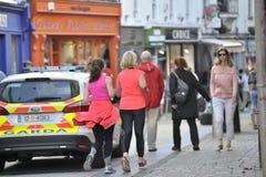 Shop Street, Galway, Ireland june 2017 , Man and dougther joggin. Near to a Garda car Stock Photos