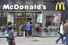Shop Street Galway, Ireland June 2017, Mc Donald`s fast food re. Staurant, some people entering to the restauran Royalty Free Stock Photos