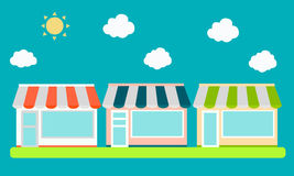 Shop. Street with shops on the background of blue sky with the sun Royalty Free Stock Photos
