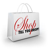 Shop Till You Drop Shopping Bag Sale Discount Advertising. Shop Till You Drop words on a white shopping bag to illustrate discounts and sales to encourage you to Stock Images