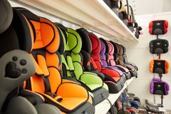 Shop of various automobile children`s armchairs Royalty Free Stock Photos