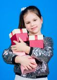 Shop for what you want. Girl with gift boxes blue background. Black friday. Shopping day. Child carry lot gift boxes. Kids fashion. Surprise gift box. Birthday royalty free stock photos