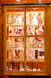 Shop window with christmas decoration - Fenster mit weihnachtlicher Dekoration. Traditional old wood window with Christmas angels and nativity scene figures Royalty Free Stock Photos