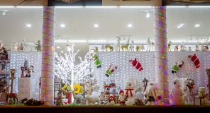 Shop Window with Christmas Decorations and Toys. Snowman, Rudolph, Santa Claus, Christmas Tree stock photo