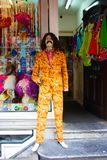 Shop window display of clothes and party costumes. mannequin dressed as a famous character with rude colors. beard and long hair royalty free stock photo