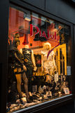A shop window on the evening streets of Amsterdam. Stock Images