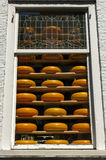 Shop window full of round Dutch cheeses, Delft, Netherlands Stock Photo