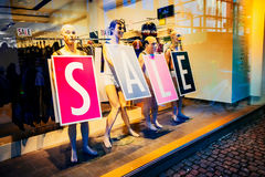 Shop window with funny mannequins announce sale in Copenhagen, Denmark Stock Images