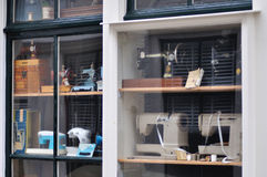 Shop window. With a lot of old sewing machines Royalty Free Stock Photo
