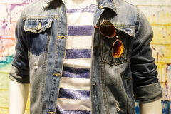 Clothes on the mannequin: jeans jacket, T-shirt, glasses. Stock Image