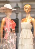 Shop window with mannequins. Mirroring the street royalty free stock photography