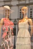 Shop window with mannequins, mirroring Stock Image