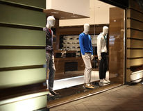 Shop window with men dressed mannequins Stock Photo