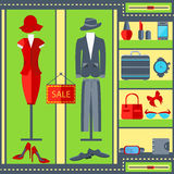 Shop window mens womens clothing suits, dresses, watches, handbags Royalty Free Stock Images