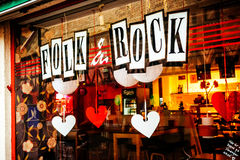 Shop window of music store with rock & folk music in Malmo in Sweden. MALMO, SWEDEN - DECEMBER 31, 2014: Shop window of music store with rock & folk music in Royalty Free Stock Images