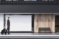 Shop window, poster, bench, black, man Royalty Free Stock Image