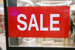 Shop Window With Sale Sign at shopping mall royalty free stock image