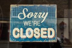 Shop window sign sorry we`re closed. Hanging at door of a shop on sundays and in the evening Royalty Free Stock Photography