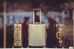 Shop window with suitcases. Shop window with fashionable suitcases, goods for tourism and travel Stock Photography