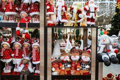 Free Shop Window With Christmas, New Year S Toys And Decorations. Funny Snowmen And Santa Claus In A Toy Store. Festive Winter Trade Royalty Free Stock Images - 163429189