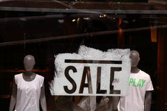 Shop window with the word SALE and two mannequins Royalty Free Stock Photos