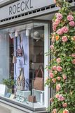 Shop windows and flowers in Zurich. Street photo stock image