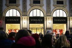 Shop windows of the VERSACE luxury boutique store in Galleria Vittorio Emanuele II gallery at night stock photo