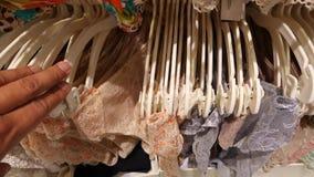 Shop of women`s underwear. Women`s panties on hangers in a sex store, 4k, slow motion stock video
