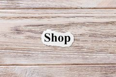 SHOP of the word on paper. concept. Words of SHOP on a wooden background stock photo