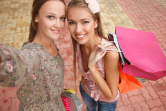 Shopagolics heureux Photographie stock