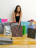 Shopaholic with all her shopping bags Stock Photo