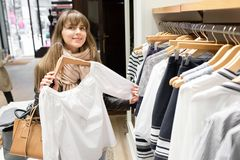 Shopaholic beautiful happy woman goes shopping in the city. The concept of shopping, sales and purchases of things. Shopaholic beautiful happy woman goes Stock Photography