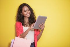 Shopaholic checking stuff at online store on tablet. Portrait of shopaholic checking stuff at online store on tablet Royalty Free Stock Photos