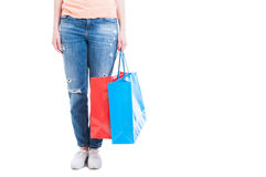 Shopaholic concept with woman holding big shopping bags Royalty Free Stock Photos