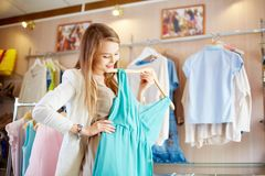 Shopaholic with dress Stock Photography
