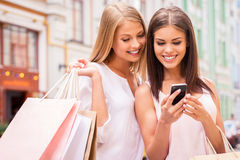 Shopaholic friends. Stock Photos
