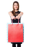 Shopaholic girl holdng shopping bags Royalty Free Stock Photography
