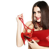 Shopaholic Girl with Red Jewelry, Shoes and Handbag Royalty Free Stock Photos
