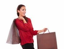Shopaholic hispanic female with shopping bags Royalty Free Stock Photography