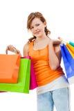 Shopaholic joven atractivo feliz Fotos de archivo