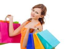 Shopaholic joven atractivo feliz Imagenes de archivo