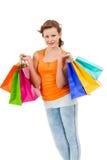Shopaholic joven atractivo feliz Fotos de archivo libres de regalías