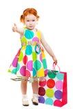 Shopaholic liten flicka arkivfoto
