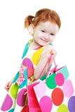 Shopaholic liten flicka royaltyfria bilder